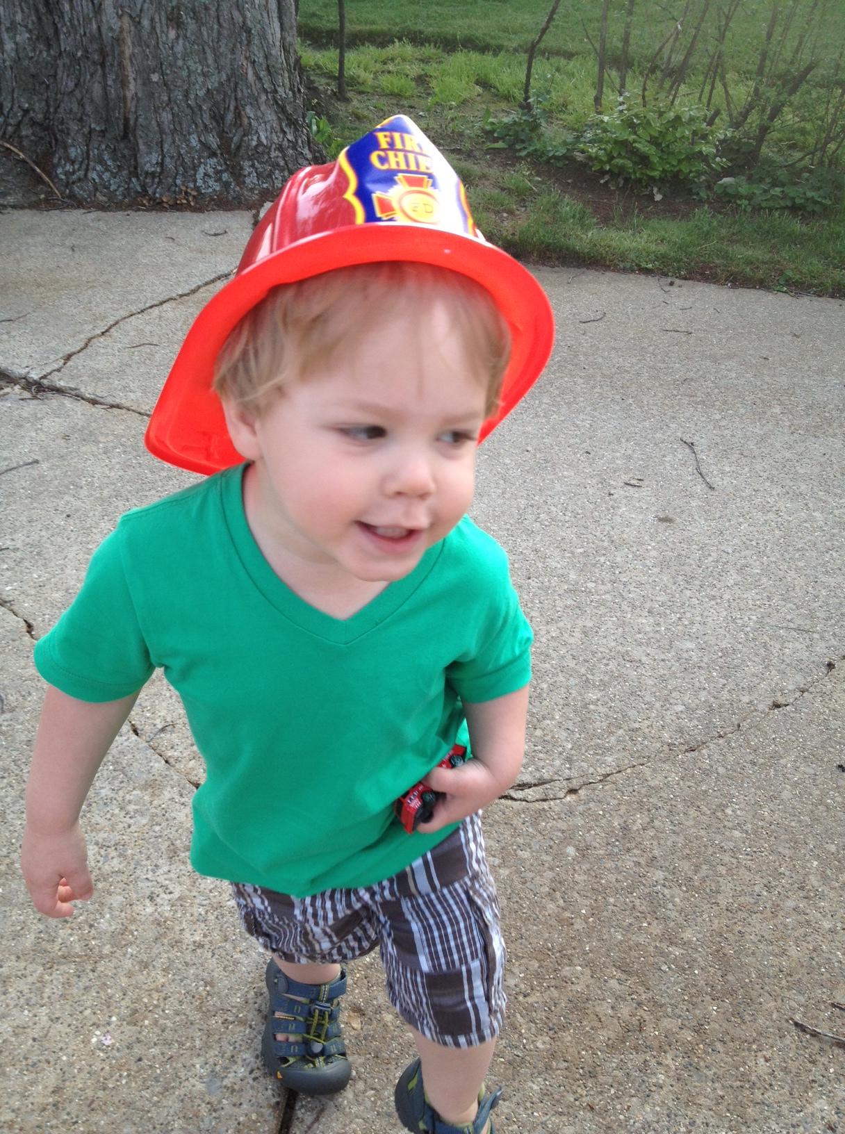 """i asked h to show off his hat for me later so i could snap a photo. this """"action"""" shot and a big """"Cheese!"""" was what i got in reply."""