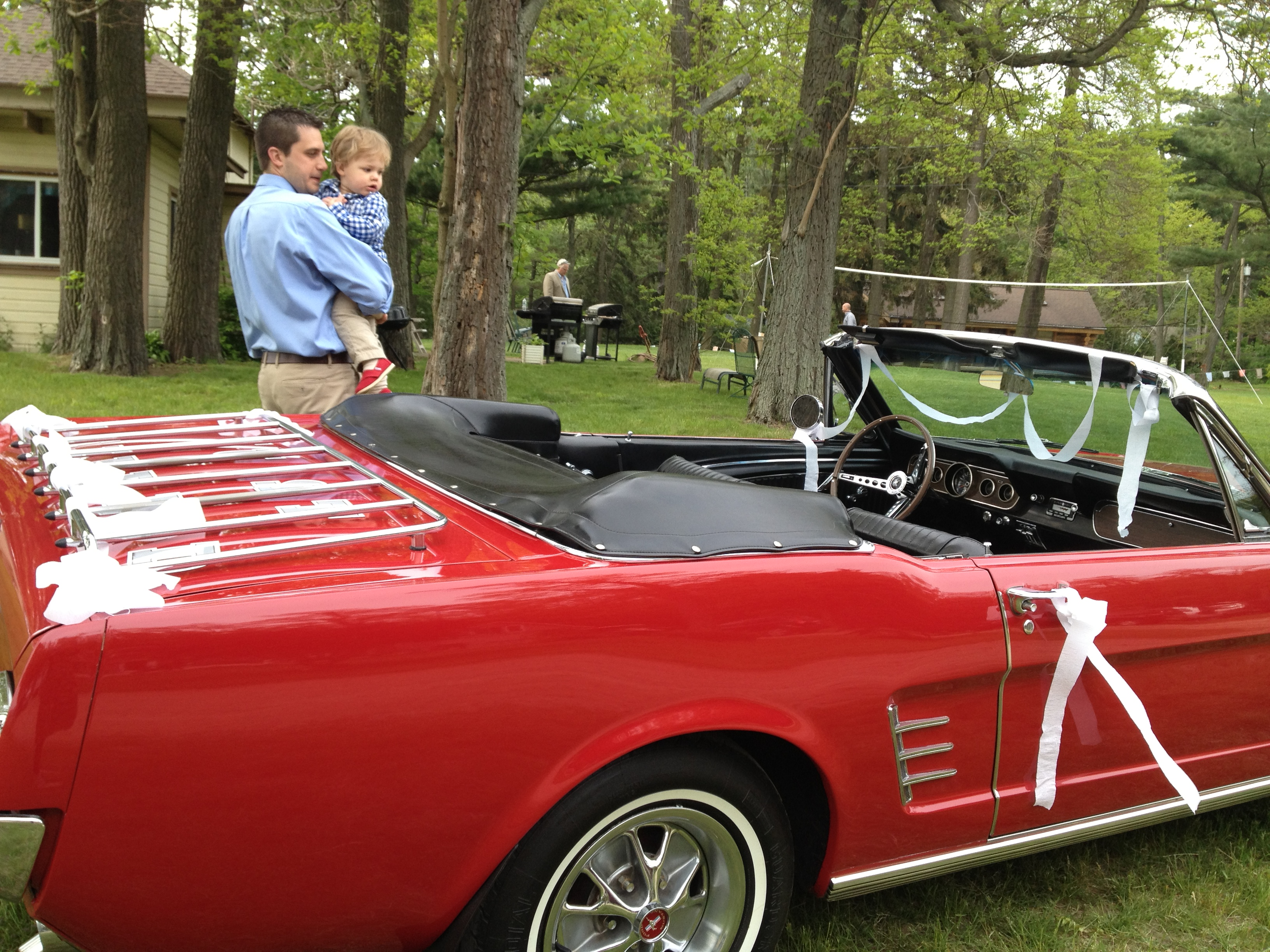 two handsome boys and a classy getaway car.