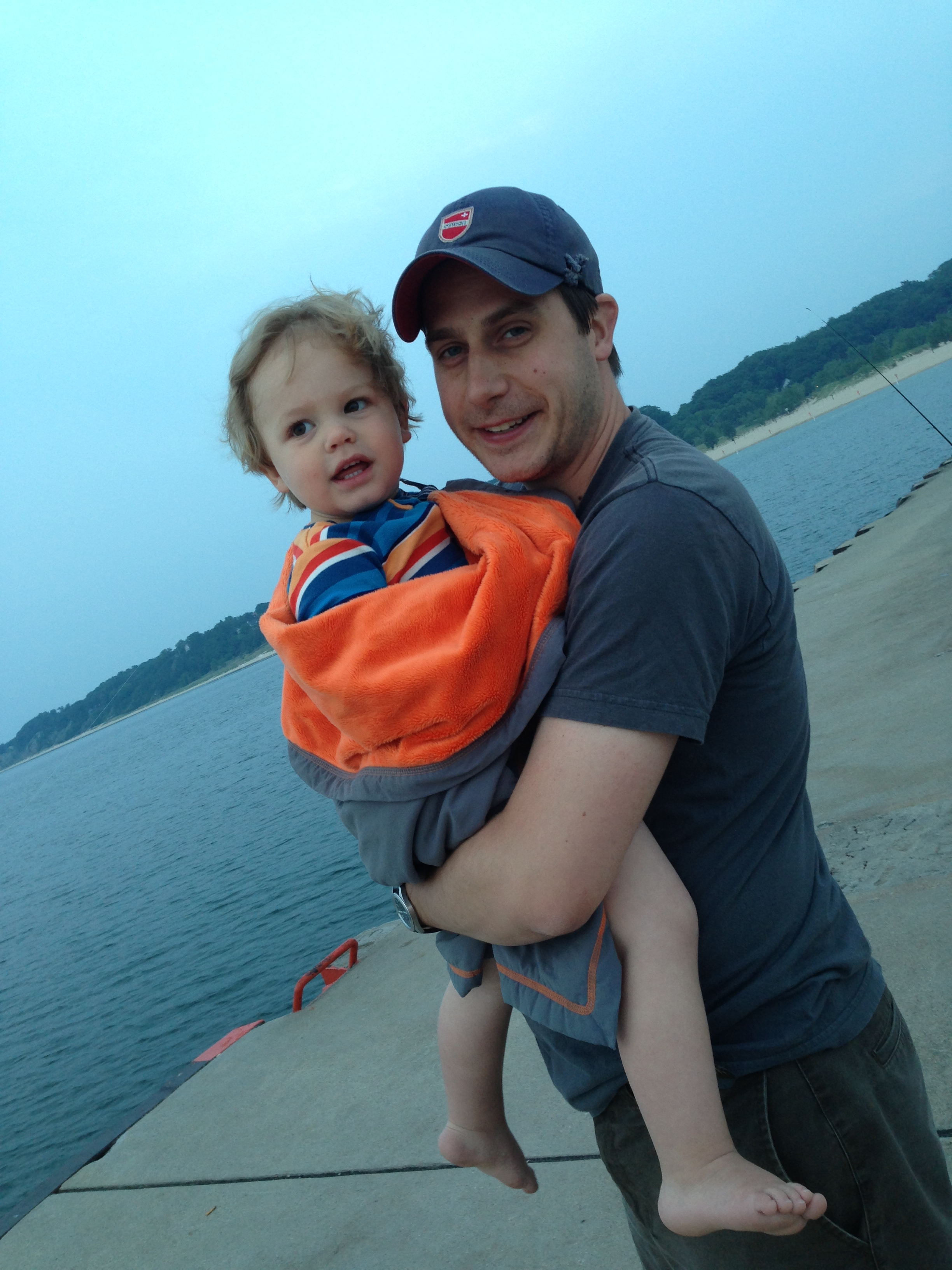 hank and dad at the end of the day. h can't take his eyes off of the barge that's dredging the lake ;)
