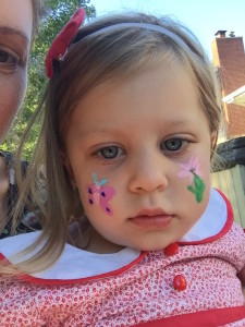 """completely zoned and ready for bed, but she sure did love her face paint (and was determined to wear her """"party dress"""" to celebrate, too. :)"""