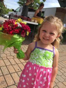 ...while this little lady shone brightly toting a summery market bouquet.