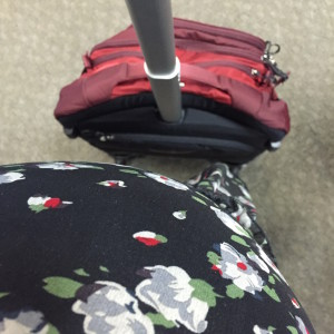 33.5 week along travel companion and I waiting to board our second flight. The bump is just about as big as my carry on, but they didn't charge me extra. ;)