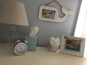 Dresser details...lamp is Threshold from Target, whale frame and knot frame from HomeGoods. Owl nightlight/soother is SkipHop.