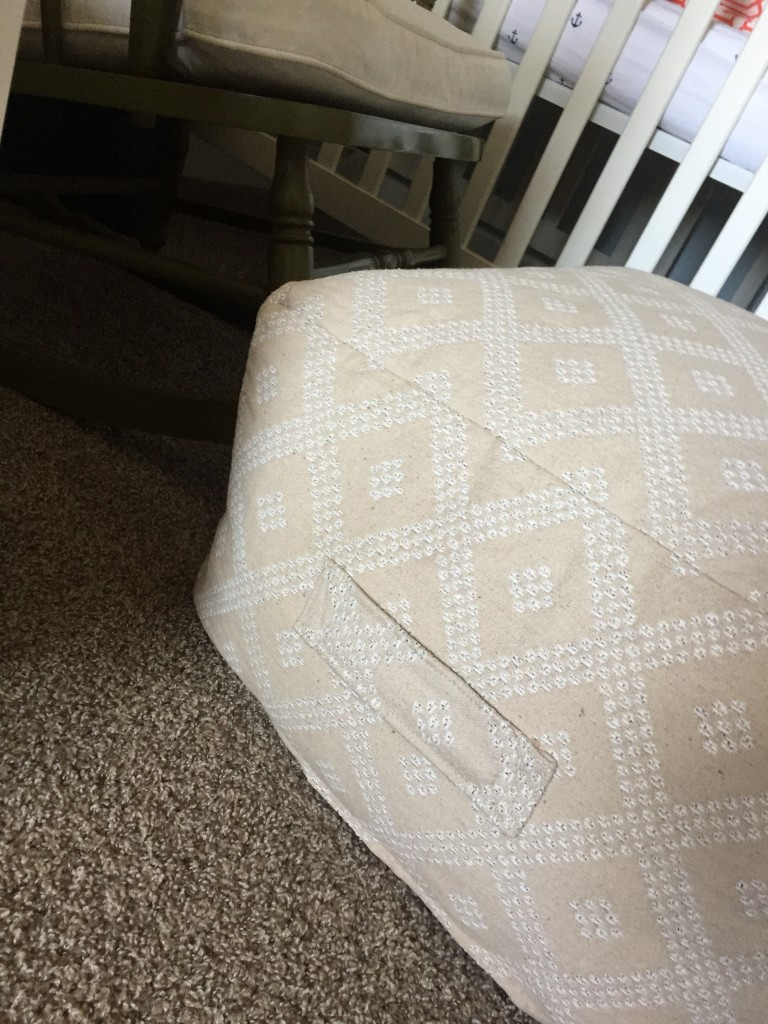 Super cozy, cushy pouf from HomeGoods that was just a lucky find. Everything else I liked was $80 or more, and I grabbed this up for $30. Love the handle feature, because in the small rocker space, I'll likely move this around a bit.
