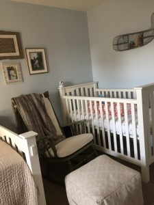...our rocker (amazing garage sale snag) and crib (Pottery Barn Kids) from Eloise's nursery, repurposed. The empty space in the corner above the crib will host a precious crocheted mobile with tiny sea creatures once the pieces arrive and I can put it together.